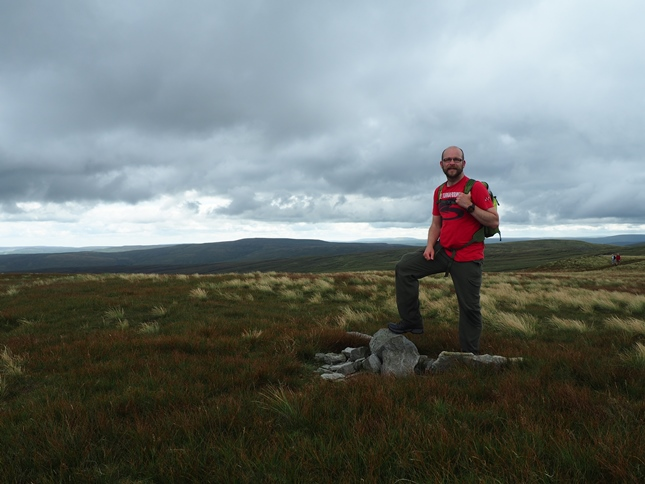 Alongside one of a number of small cairns vying for top spot on High Seat