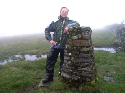 Looking very soggy by the trig point on Knoutberry Haw