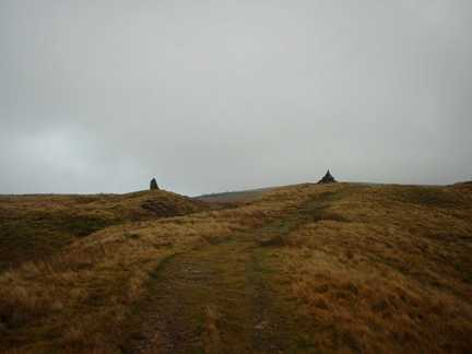Twin cairns flank the path leading up to the Nine Standards