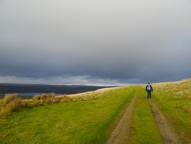 Paul on the track to Grimwith Reservoir as the cloud begins to break