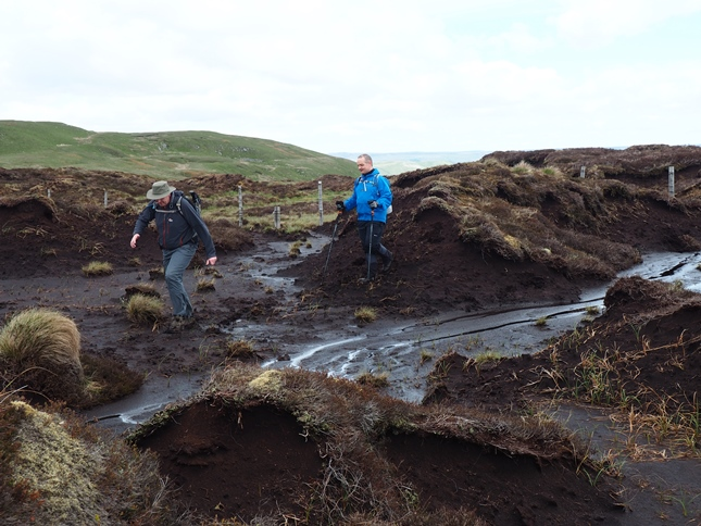 Stuart and Paul negotiating the peat hags and groughs between Woldside and Oughtershaw Tarn