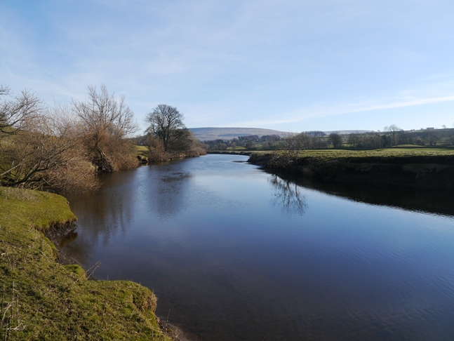 Looking east along the River Ure towards Pen Hill