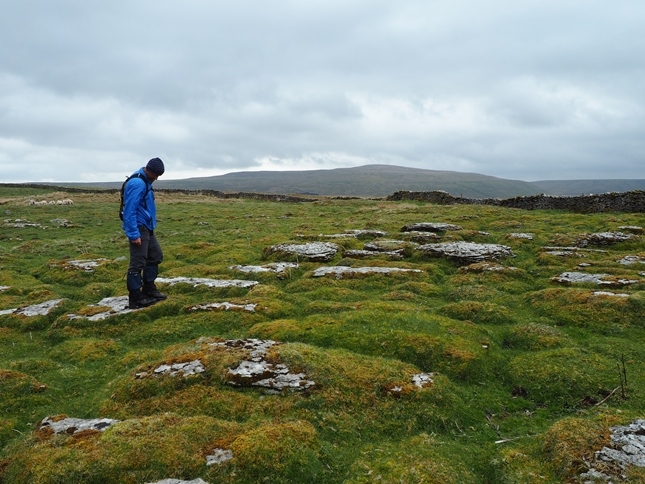 Jason on the weathered limestone of Snaizwold Fell
