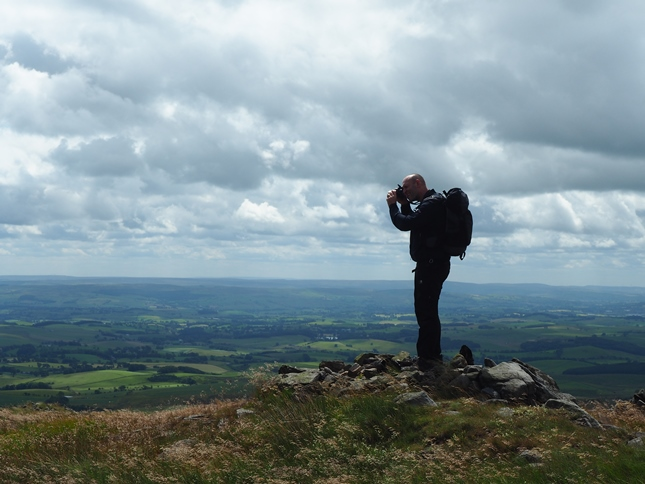 Tim taking pictures from the cairn to the south of the summit of Kirkby Fell