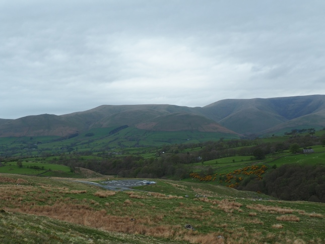 Looking back at the car park on Tom Croft Hill with the Howgill Fells in the background