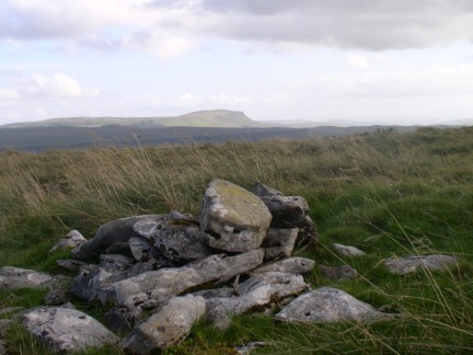 The summit cairn on Cam Fell looking towards Pen-y-Ghent