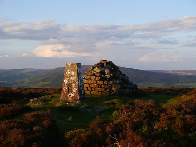 The trig point and cairn on the top of Halton Height