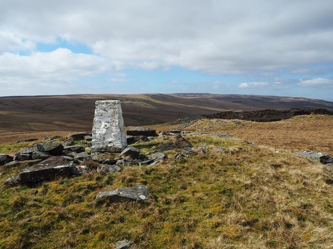The trig point on High Greygrits looking towards Brownber Head and Nine Standards Rigg