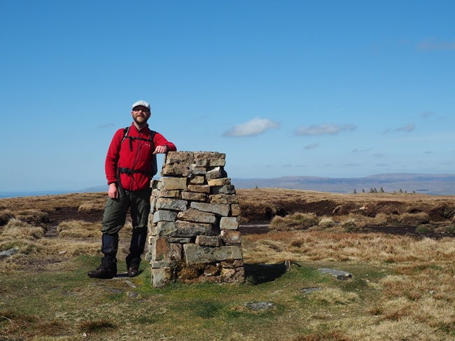 Next to the trig point on the top of Nine Standards Rigg