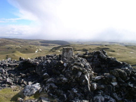 The trig point and shelter cairn on Warrendale Knotts