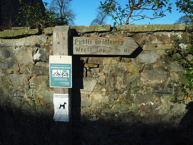 The bridleway sign in Calton pointing the way towards Weets Top