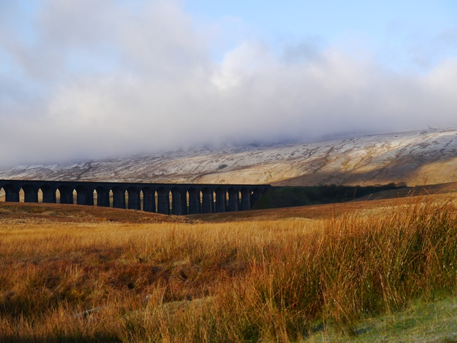 A cloud topped Whernside above Ribblehead Viaduct