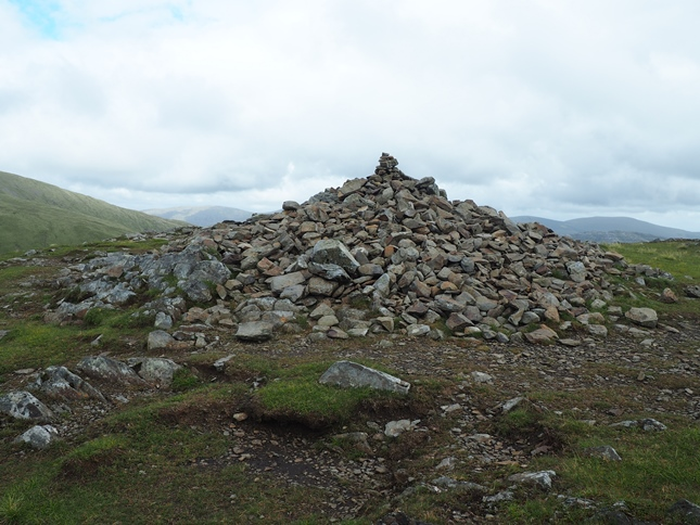 The sprawling cairn marking the summit of Benyellary