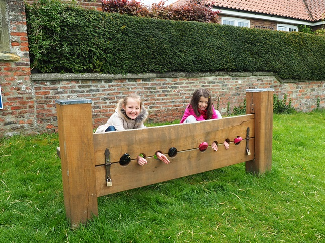 The stocks on the village green in Aldborough