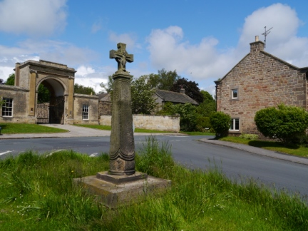 The old cross and Rudding Arch in Follifoot
