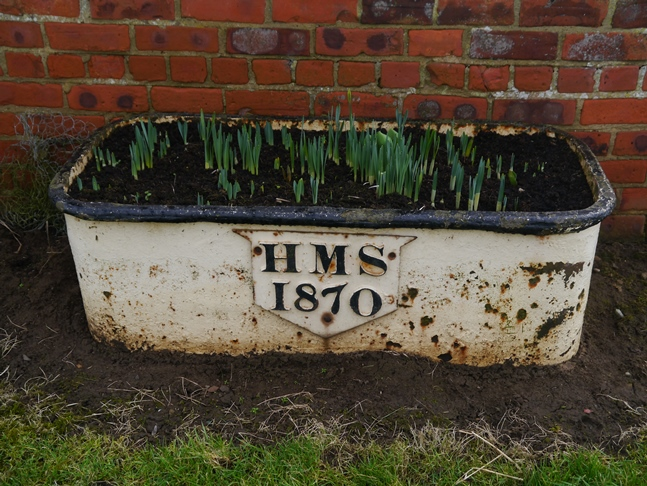 A flower pot outside Myton Home Farm featuring the initials of Henry Miles Stapylton