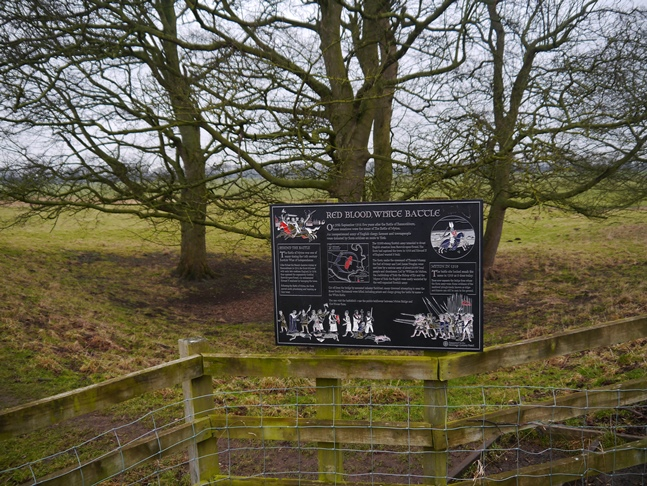 Information board about the Battle of Myton which was fought on the fields behind in 1319