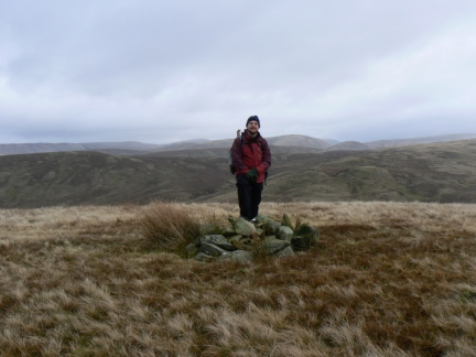 By the summit cairn on Hare Shaw