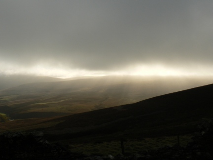 The sun breaks through the cloud over Beinn-y-Phott