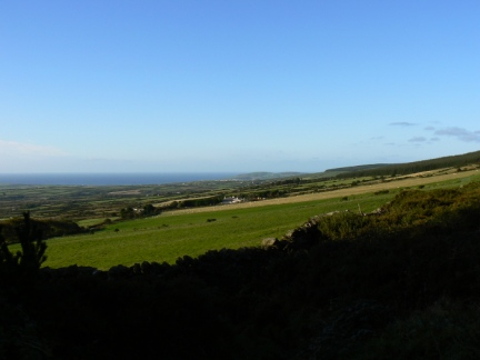 Looking south west along gently sloping fields to Port St Mary