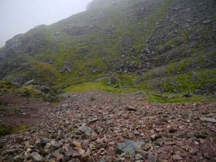 Looking back down the scree to the tiny Foxes Tarn