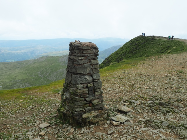 The trig point looking towards the summit of Helvellyn