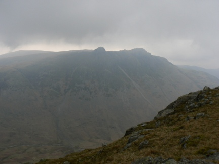 The cloud lifts above the Langdale Pikes