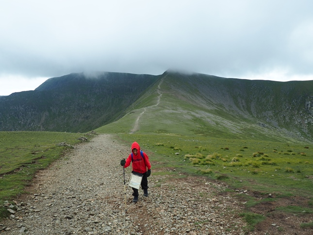 Liam heading for White Side with Helvellyn in the background