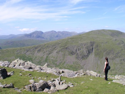 Lisa looking past Grey Friar towards the Scafells
