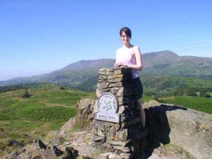 Lisa on the top of Black Fell