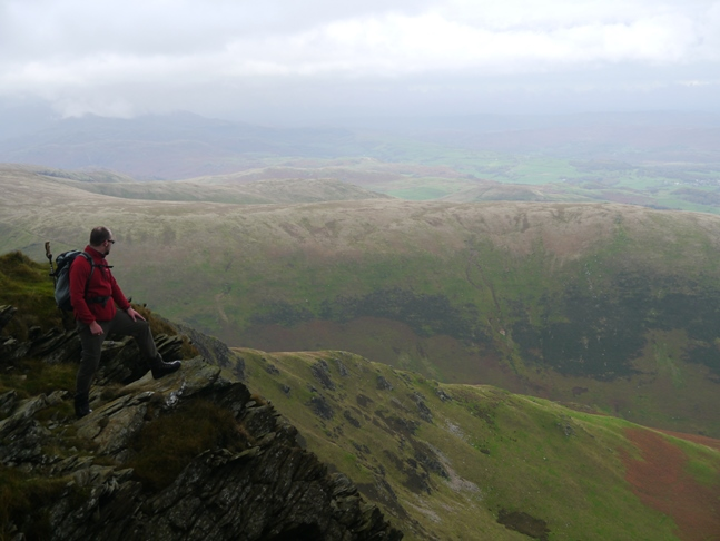 Enjoying the dramatic view from Blackcombe Screes
