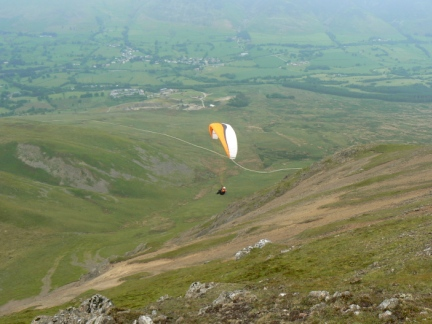A paraglider below Clough Head
