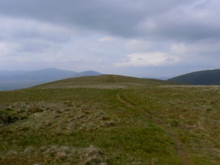 The broad grassy top of Souther Fell