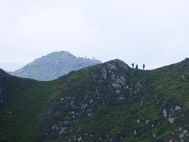 An interesting perspective of walkers on Swirral Edge and Striding Edge
