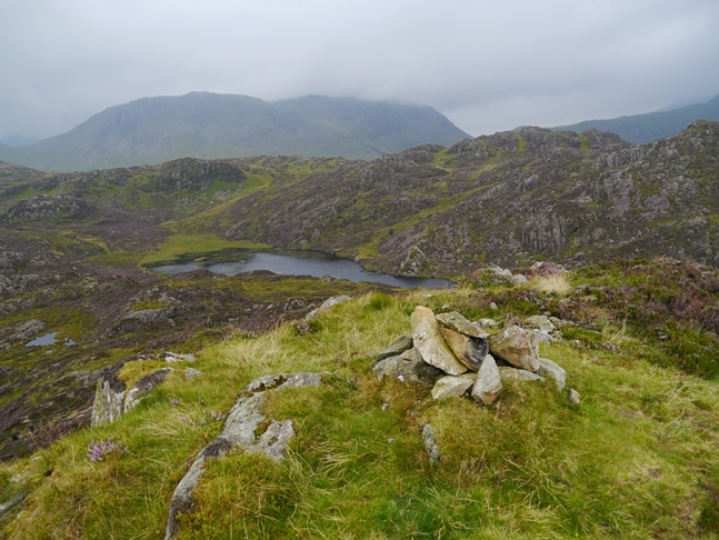 The top of Green Crag looking towards Blackbeck Tarn