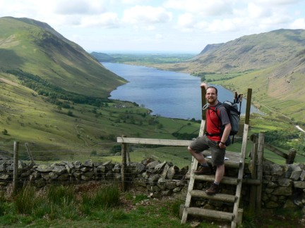 Crossing a stile on the climb up on to Lingmell