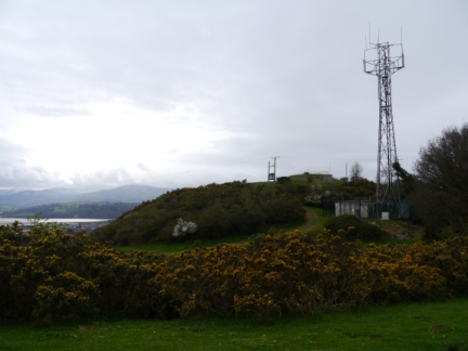 The mast and covered reservoir on the top of Bryn Pydew