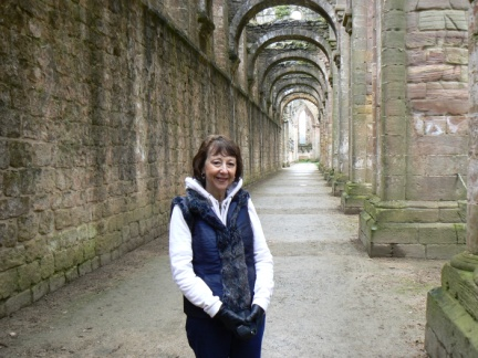 Mum standing in the north aisle of the Abbey church