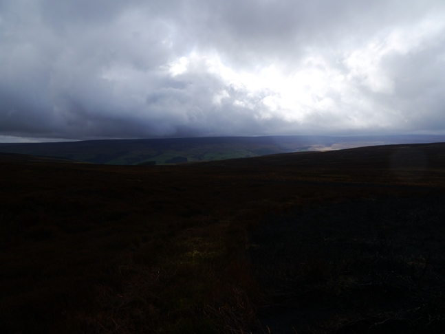 A patch of light breaks through the cloud over Nidderdale