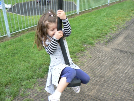Rhiannon on the zip slide in the playground in Pateley