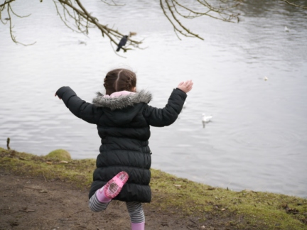 Rhiannon throwing bread for the jackdaws and seagulls