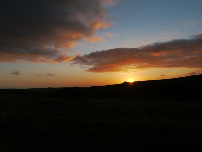 The sun rising over Hall Moor