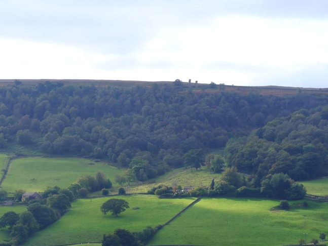 The view across the valley toward the twin pillars of Yorke's Folly