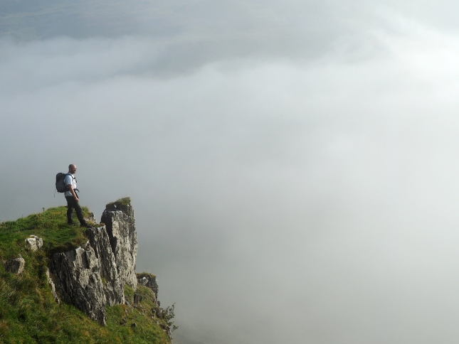 On a rocky outcrop with a cloud filled Scordale below