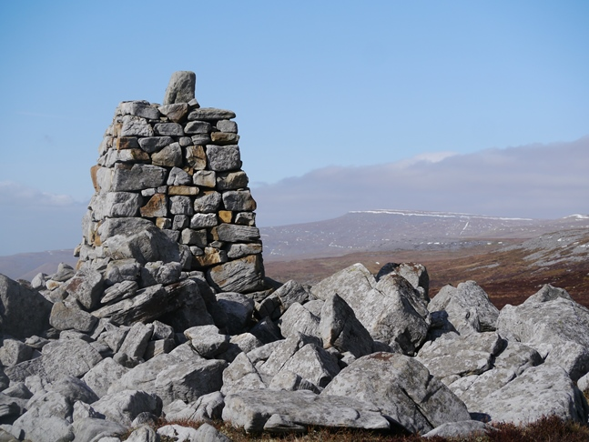 The well made cairn at 674m looking towards Cross Fell