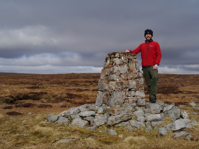 The trig point on Backstone Edge - the summit cairn can just be seen to the left of the trig