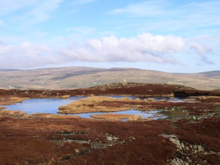 The tarn on the summit of Cronkley Fell looking to the trig point
