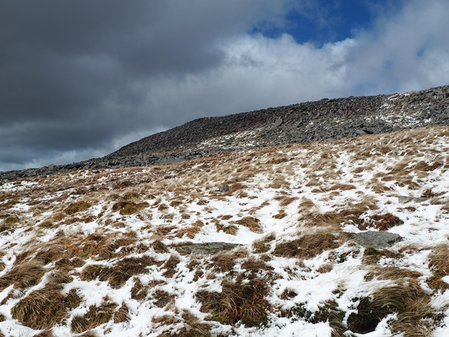 Approaching the stony ramparts defending the summit plateau of Cross Fell