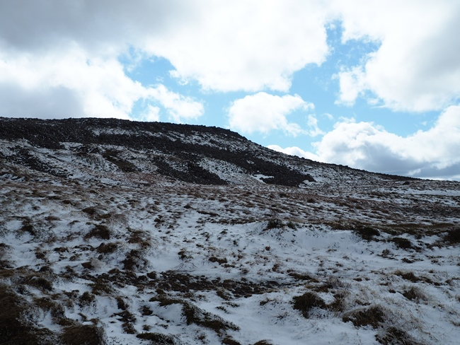 Looking back up at Cross Fell's rocky ramparts