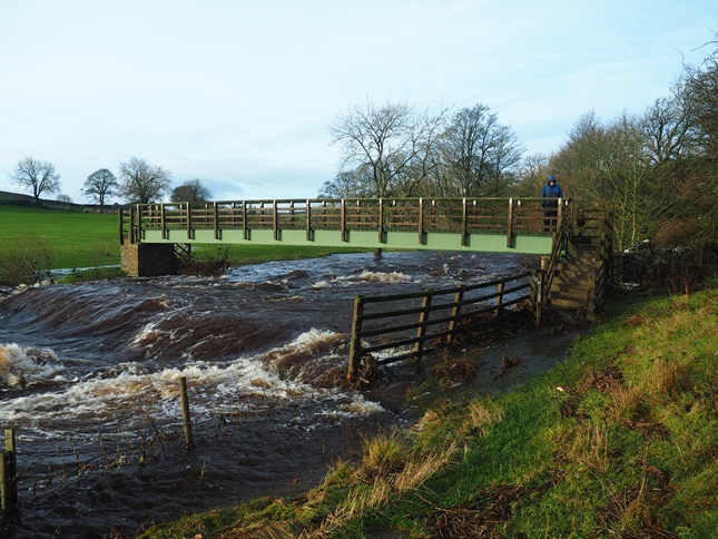 The footbridge over the River Greta, note how the foot of the steps are submerged